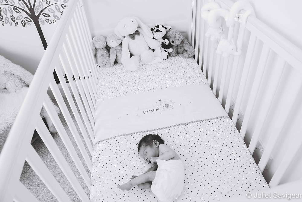 Tiny Baby In Cot