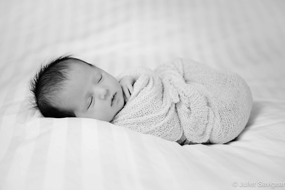 Sleeping swaddled baby