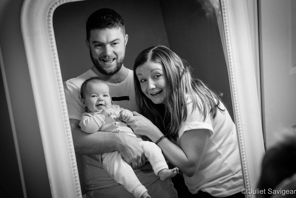 Reflections of family with baby