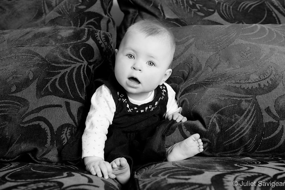 Baby sat on sofa