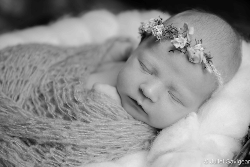 Baby girl with rose bud headband