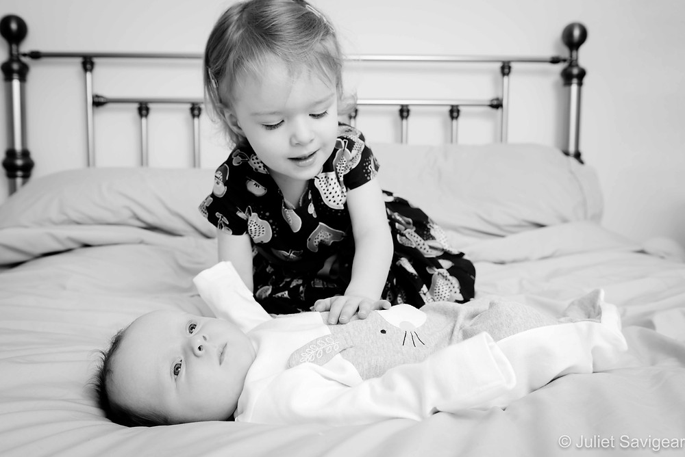 Big sister looking after baby