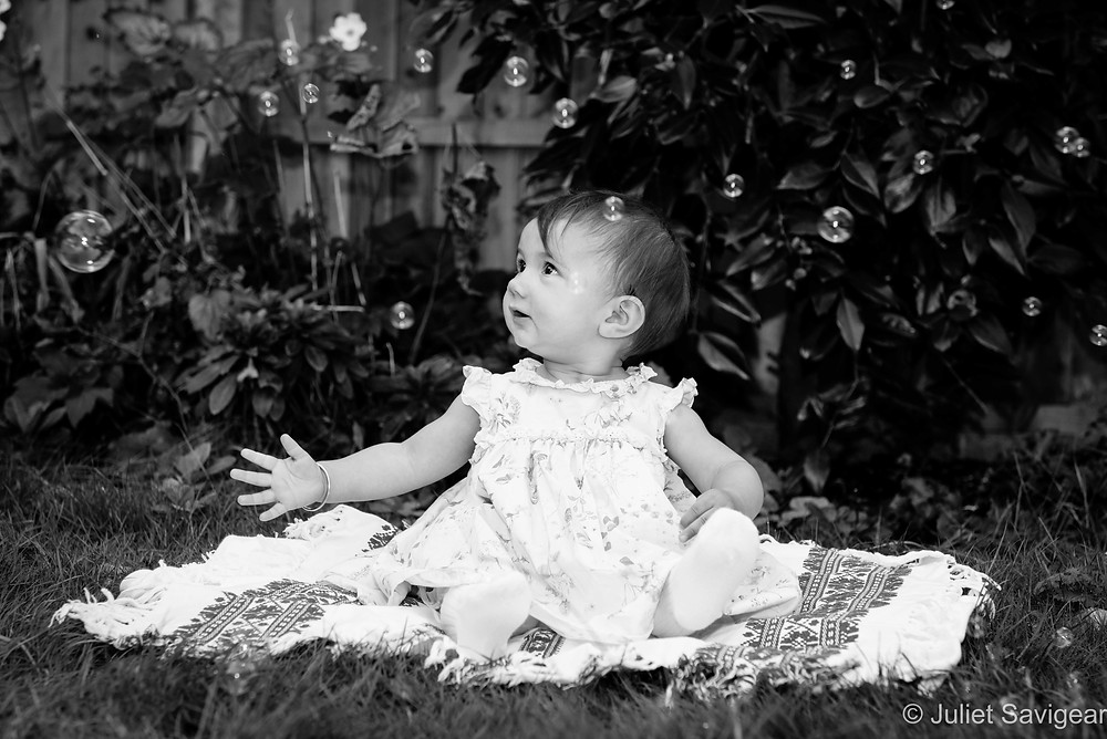Baby in the garden with bubbles
