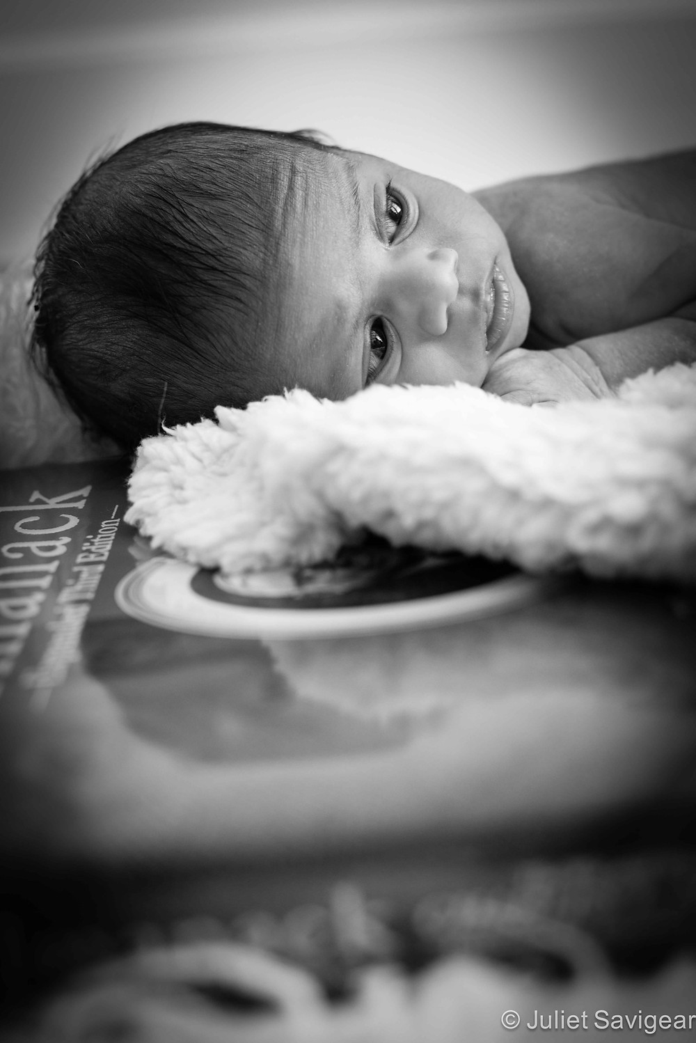 Resting On A Book - Newborn Baby Photography, Wimbledon