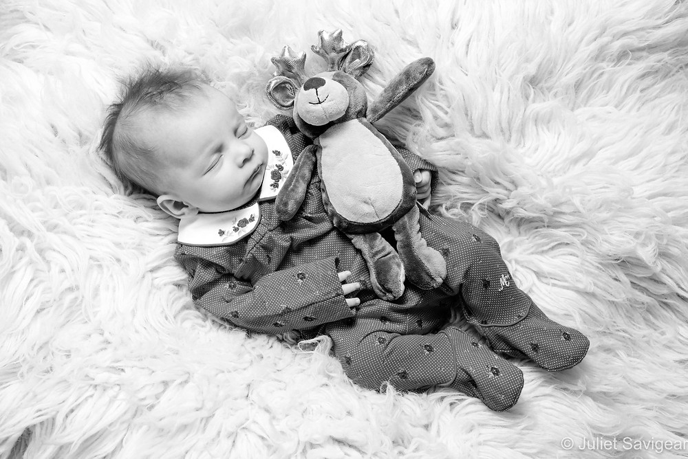 Baby with toy reindeer