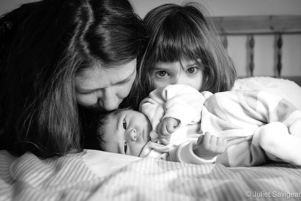 Kissing newborn baby