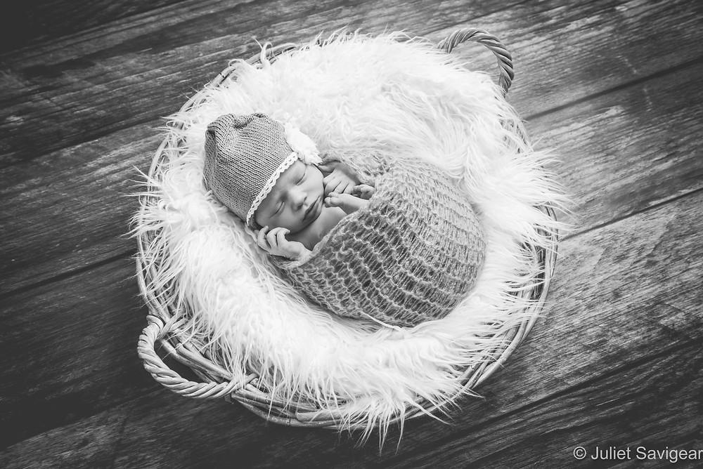 Newborn baby sleeping in a basket