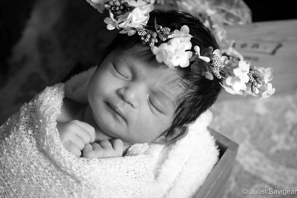 Newborn baby with wedding headband
