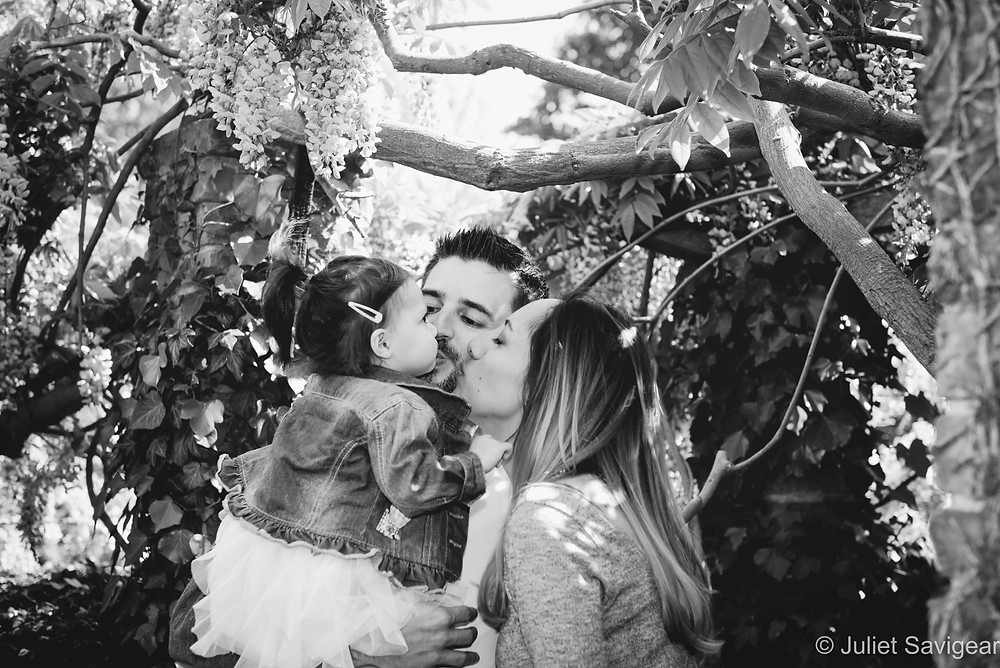 Family Kiss Under The Wisteria