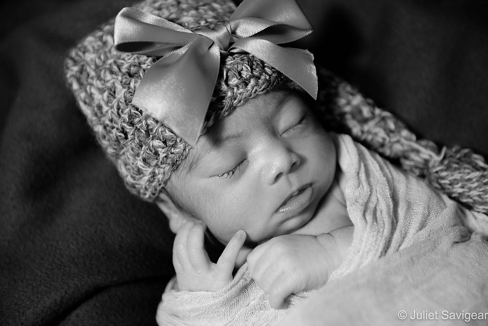 Baby in hat with bow