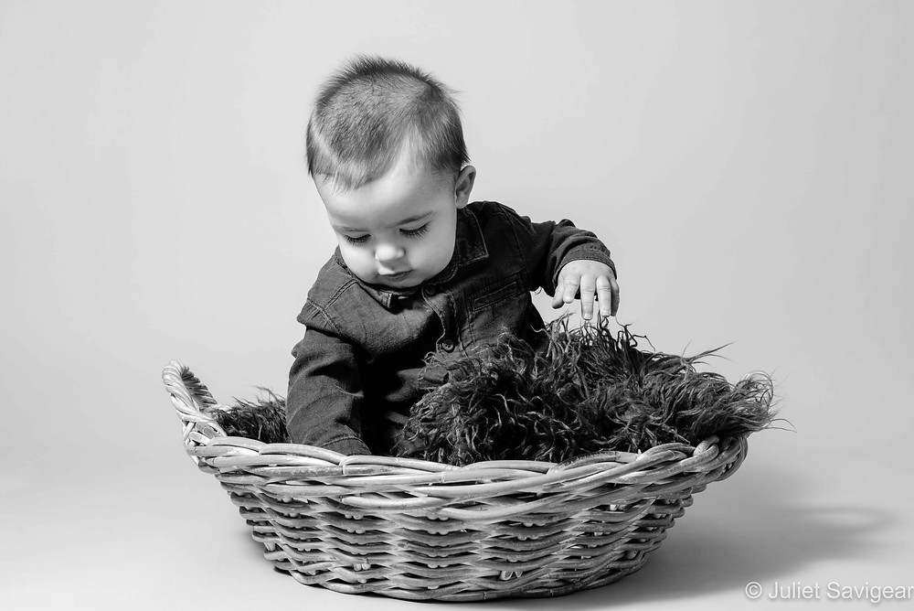 Seven month old baby in a basket