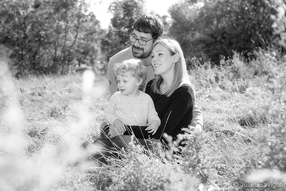 Family sitting among the grasses