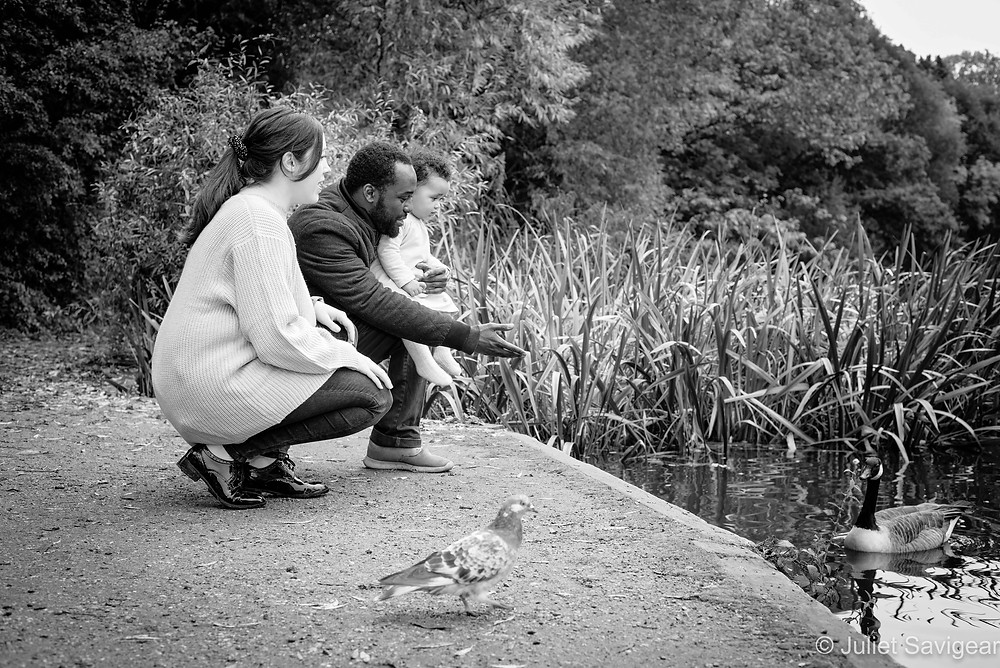 Family by pond with goose
