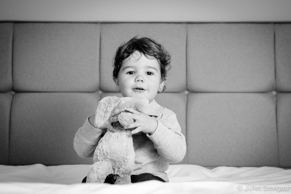 Toddler with toy rabbit