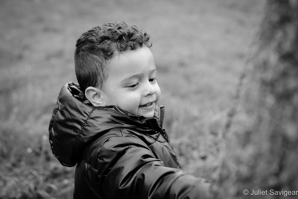 Boy by a tree