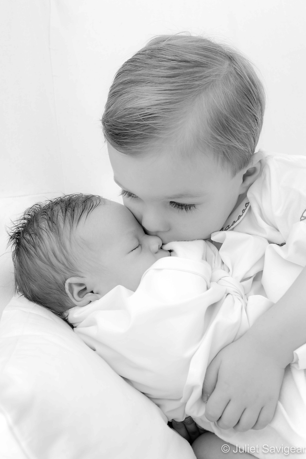 Kisses for newborn brother