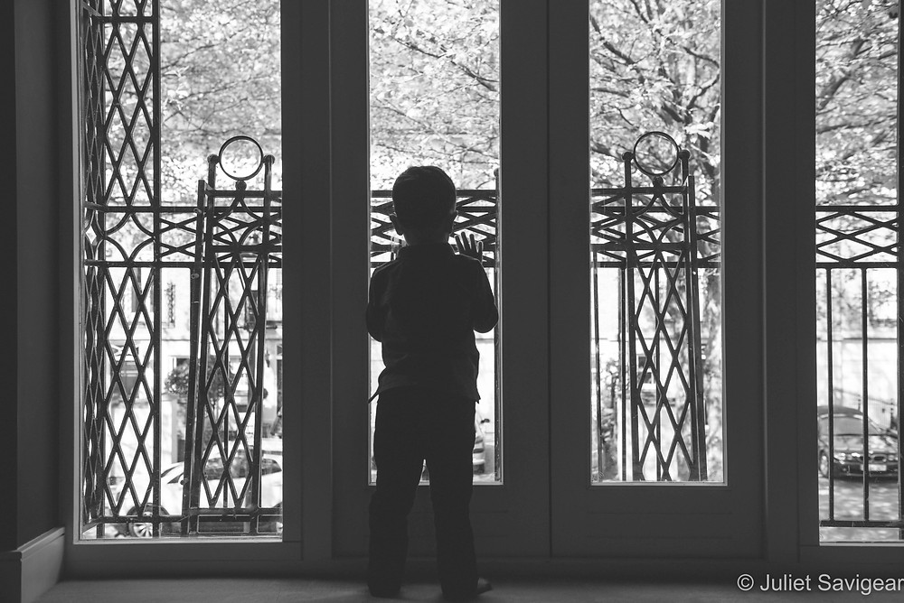 Child silhouetted at the window