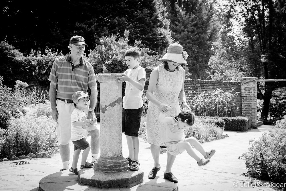 Grandparents and children by sundial