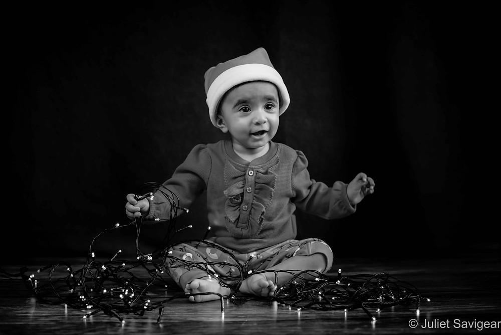 Baby with Christmas lights