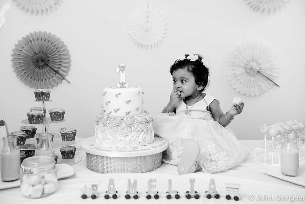 Birthday baby and cake