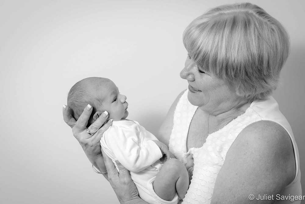 Baby in grandma's arms