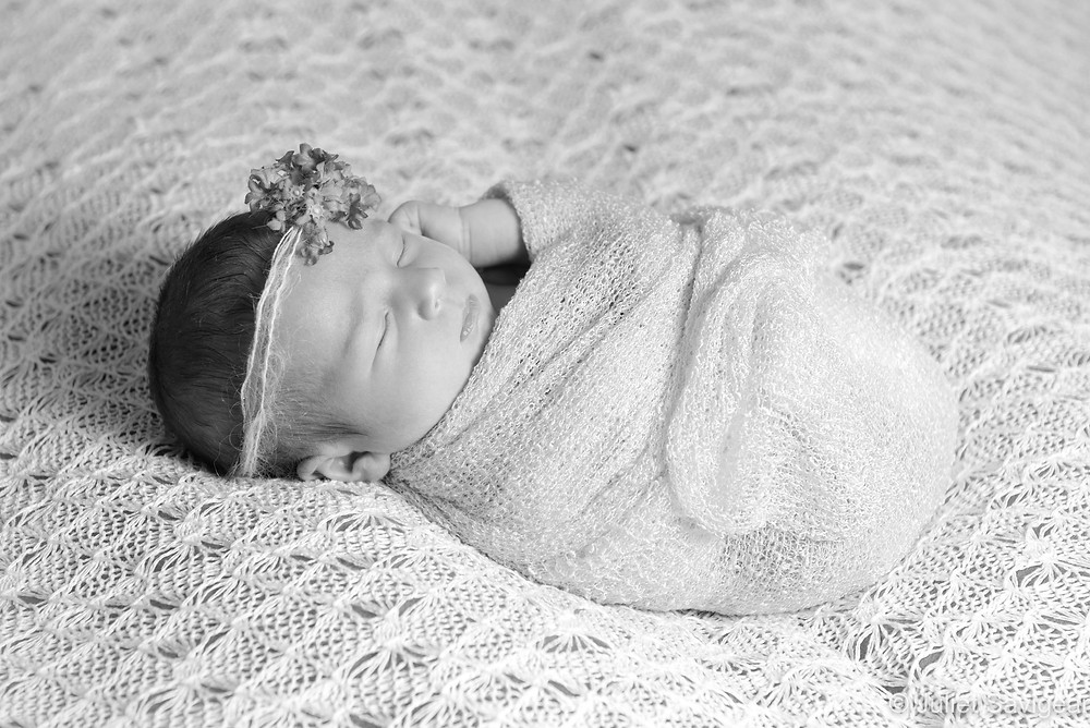 Sleeping baby on lacey backdrop
