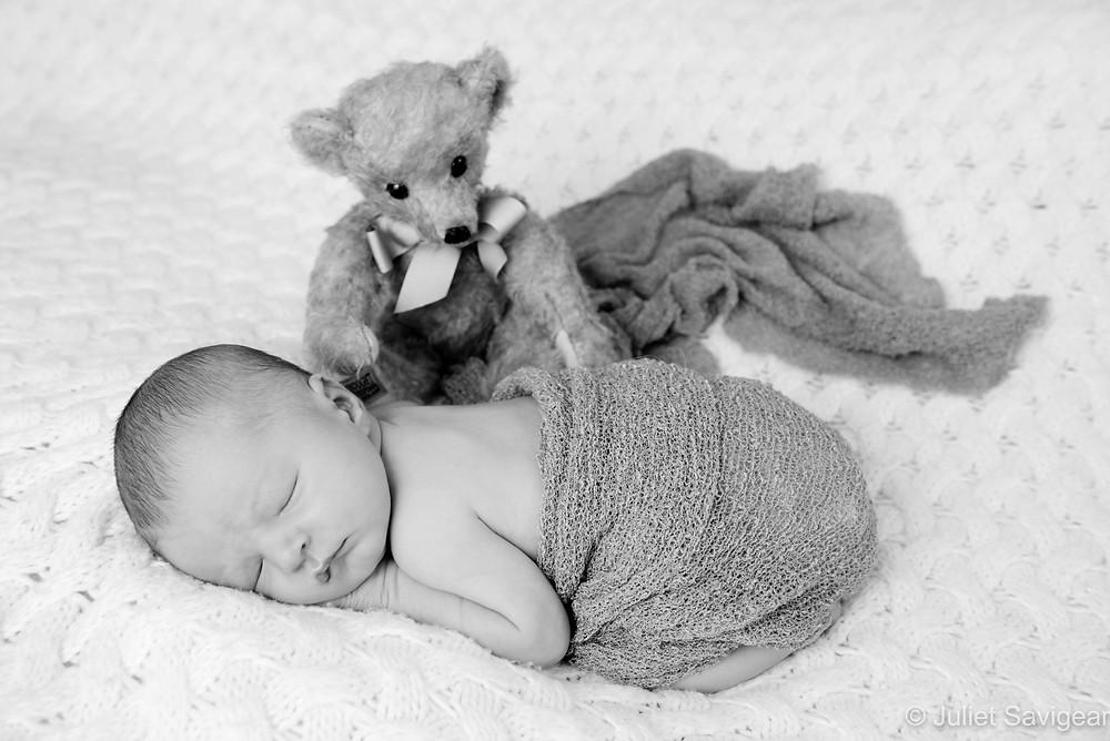 Newborn baby girl with teddy