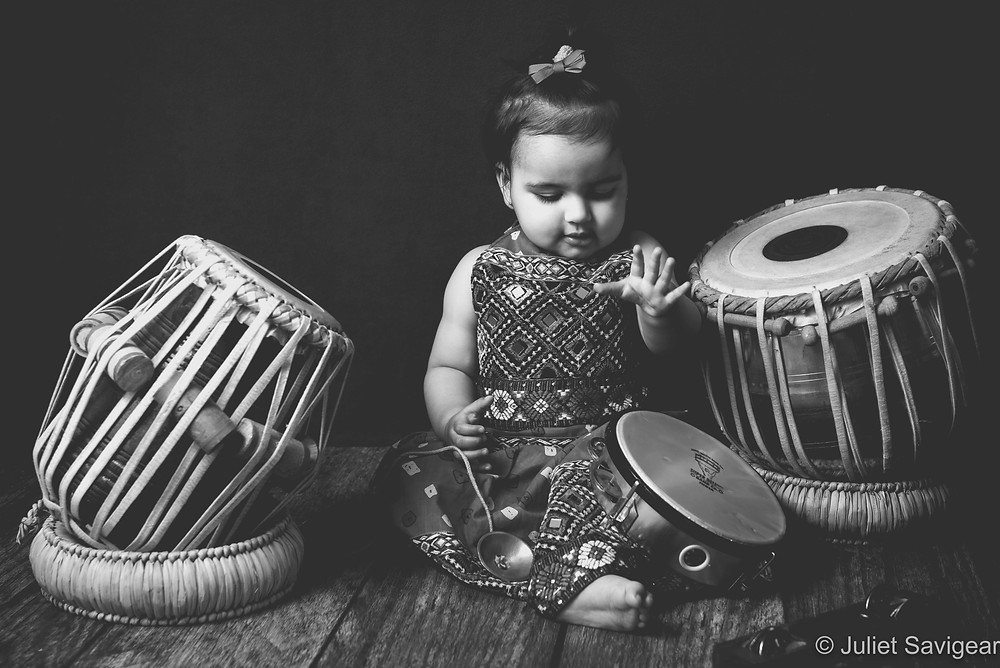Baby with Indian musical instruments