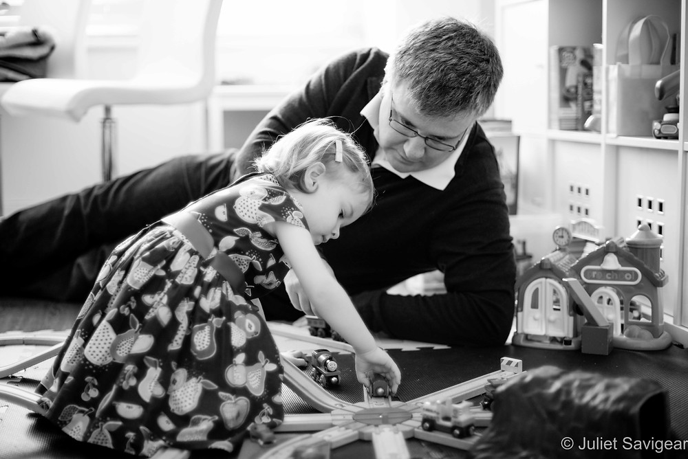 Father & daughter playing with trains
