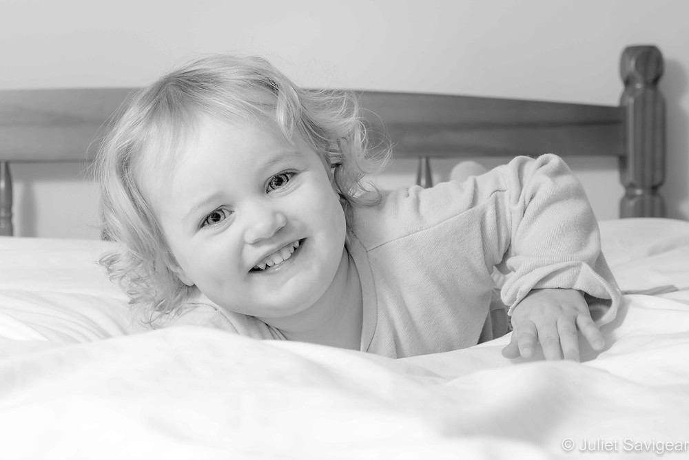 Toddler on the bed