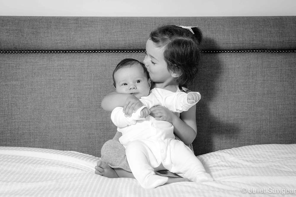 More kisses for my baby brother