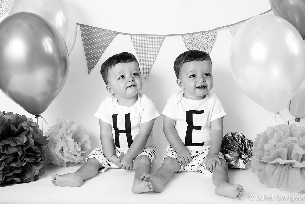 Twins with birthday balloons