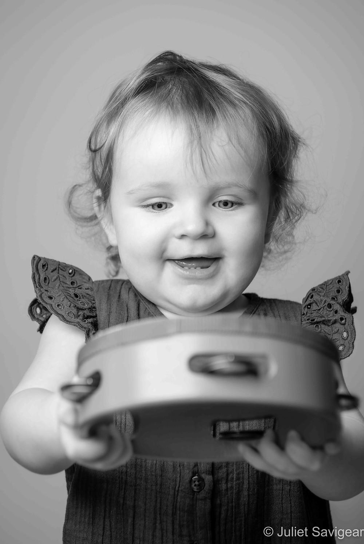 Baby with tambourine
