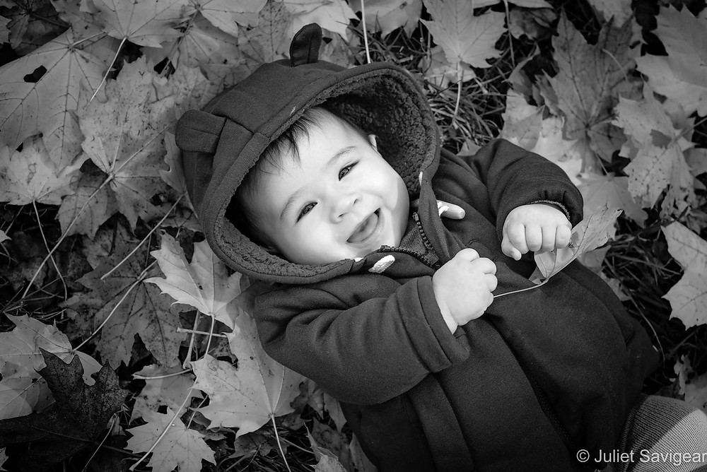 Baby among the leaves