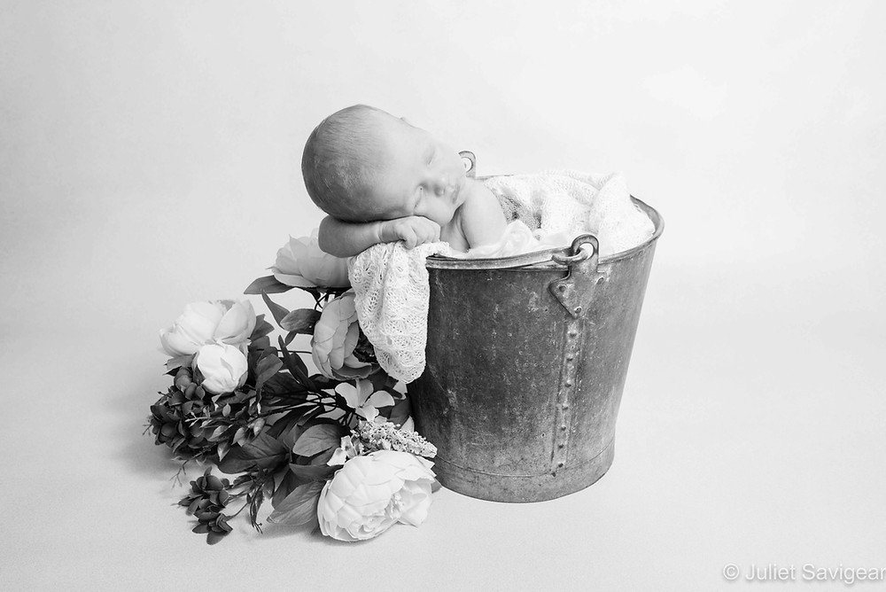 Baby girl in a bucket