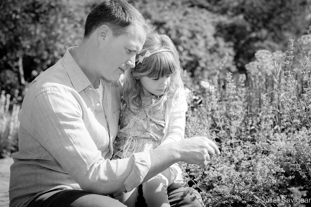 Father and daughter looking at the flowers