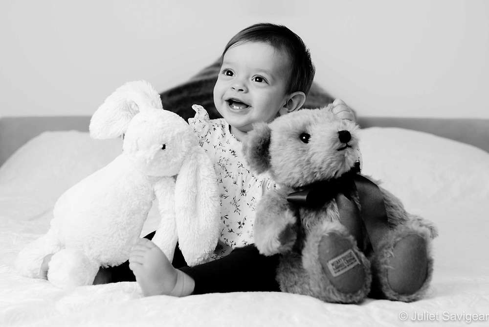 Baby with soft toys