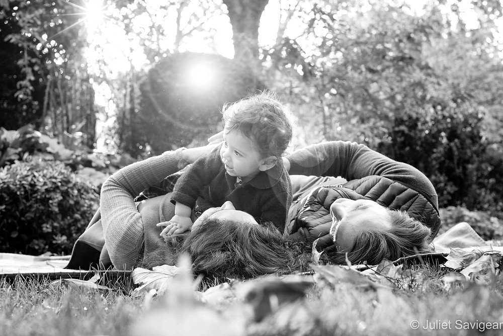 Family with baby in the autumn sunshine
