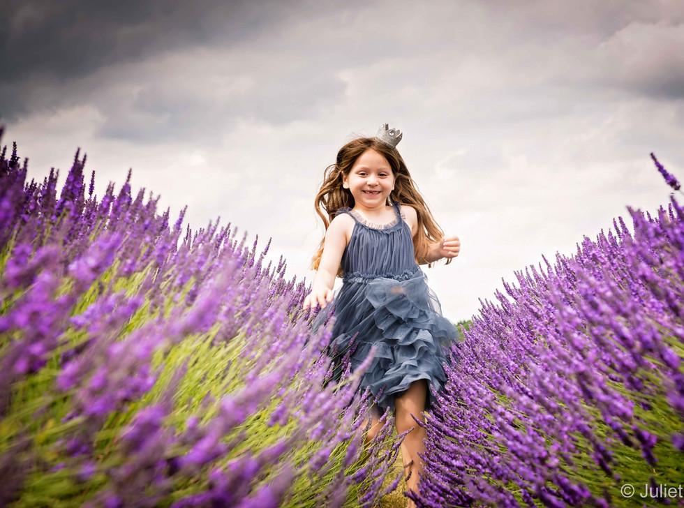 Child Running Through The Lavender