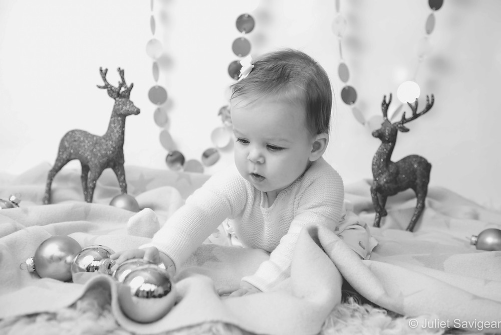 Baby with Christmas baubles