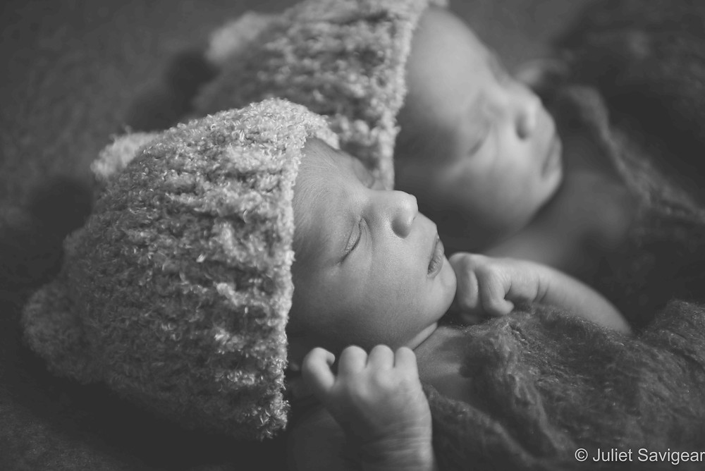 Twins in wooly hats