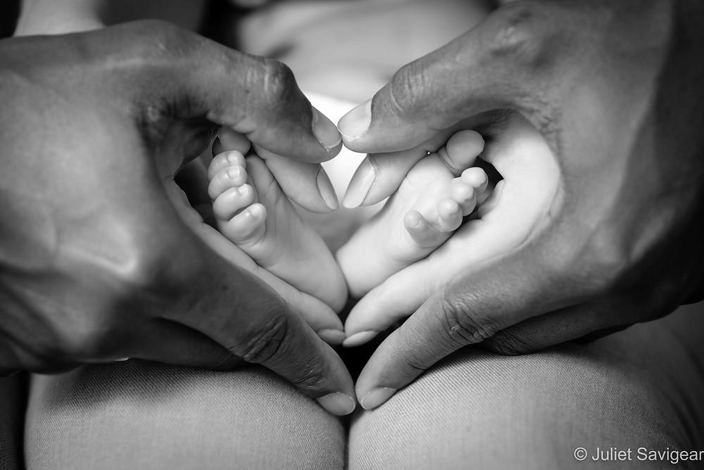 Feet in heart hands