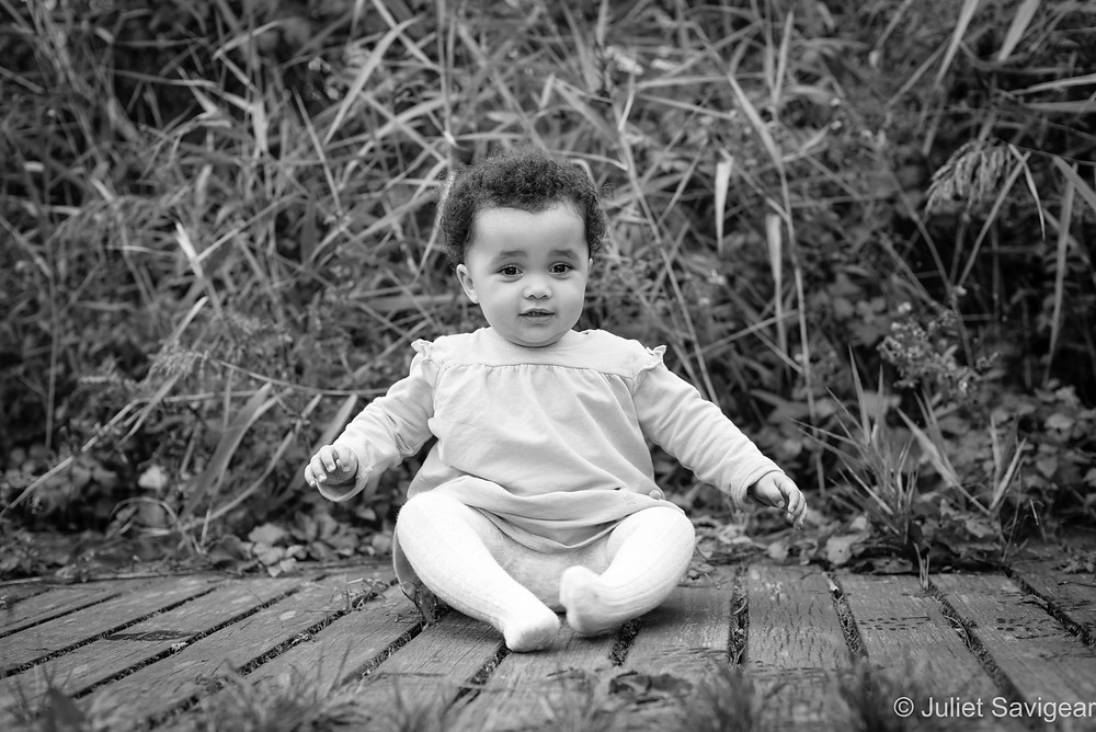 one year old baby on the pathway