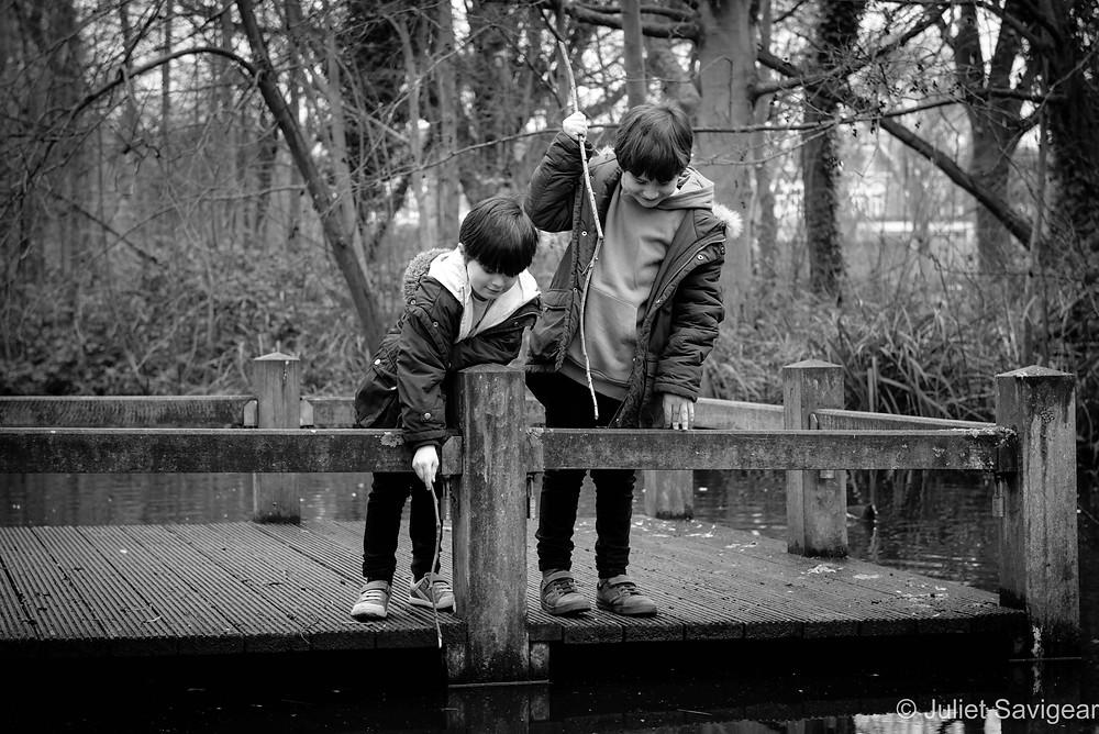Children pretending to fish