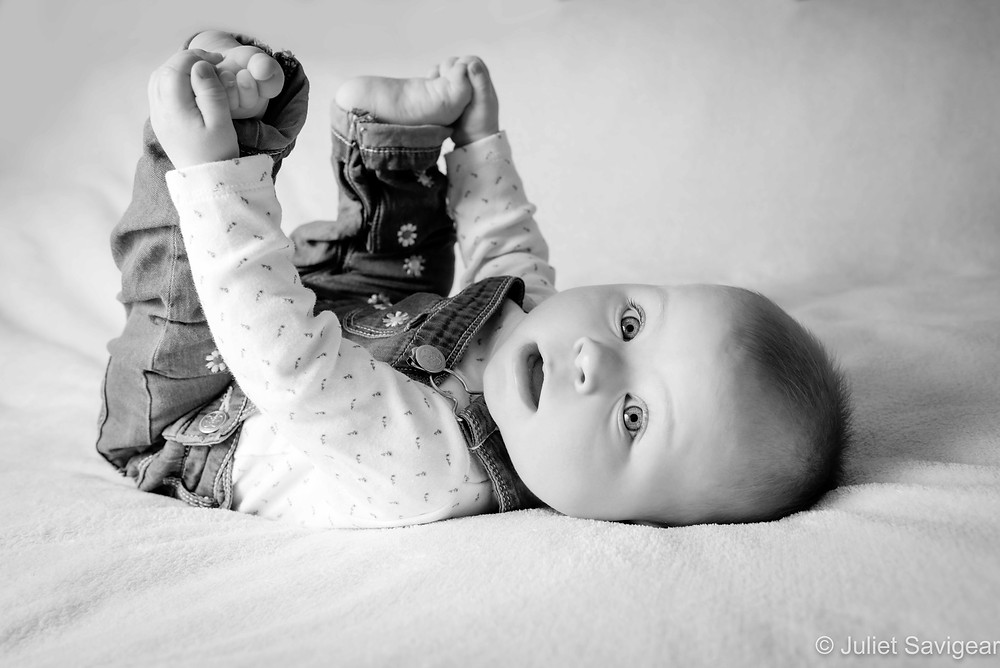 Baby grabbing her feet