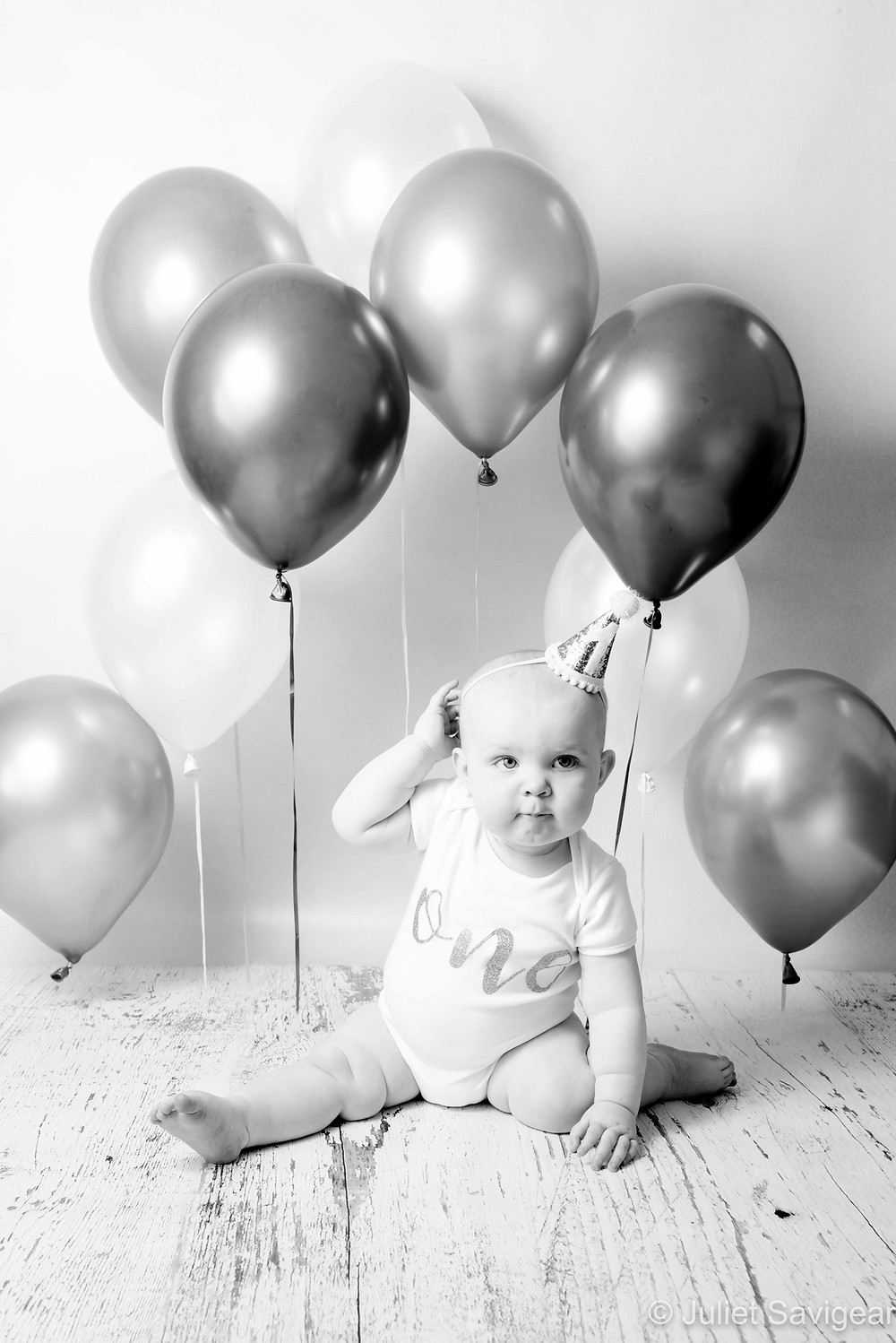 One year old baby and balloons