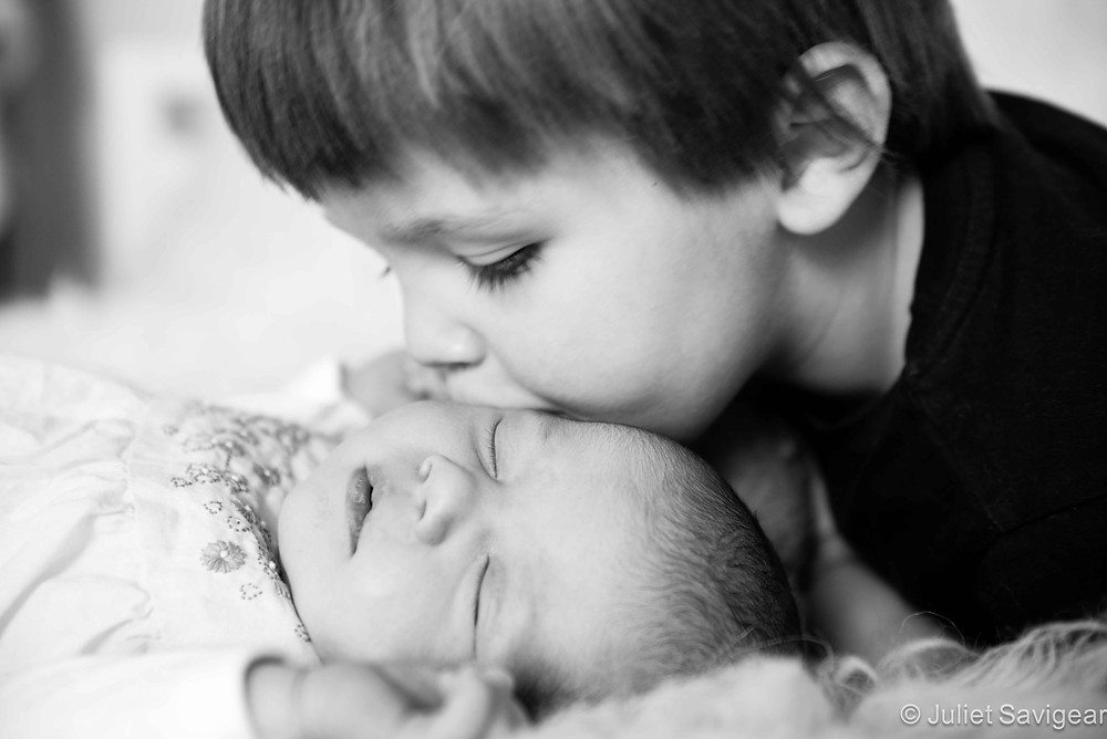 Big Brother Kissing His New Sister - Newborn Baby & Family Photography, Wimbledon