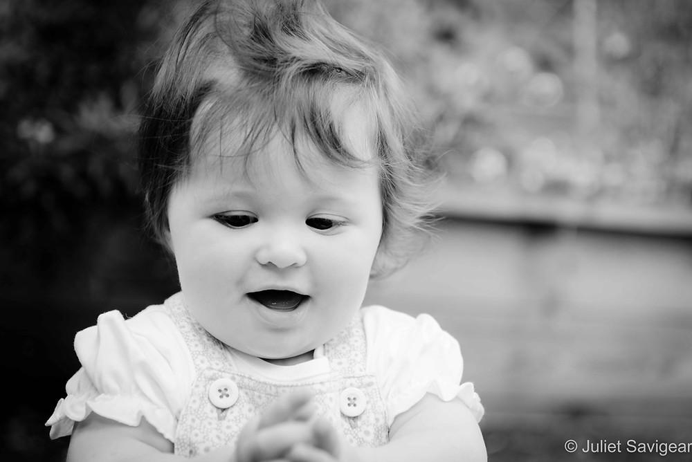 Baby Girl In The Garden