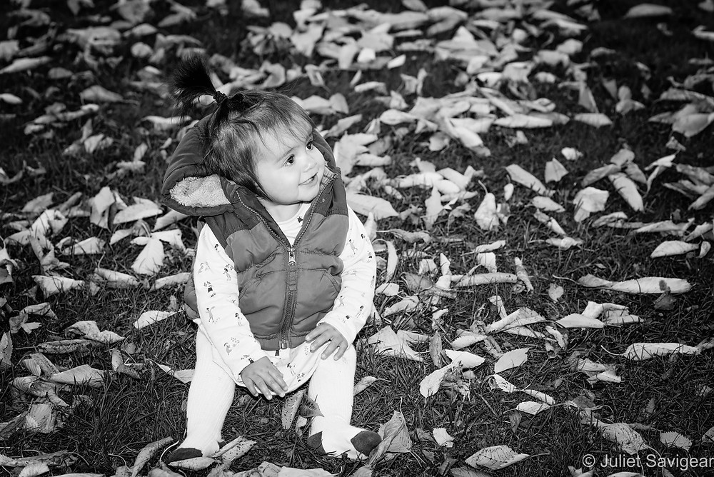 Baby by leaves