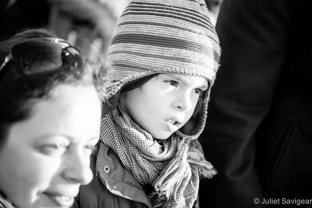 Transfixed by riverside entertainers - Family Photographer, London